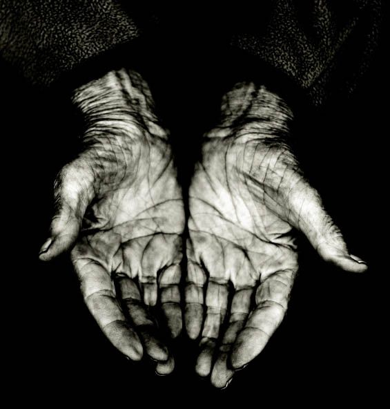 palms of a elderly woman, isolated on black copyspace, grain added